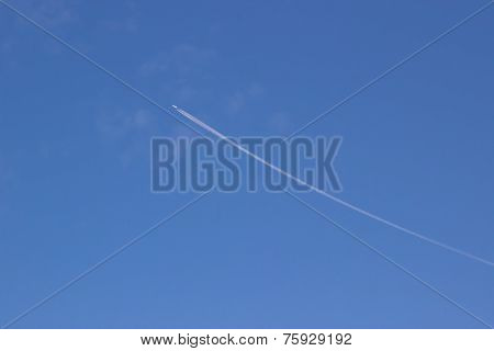 Trace of an airplane against blue sky 001