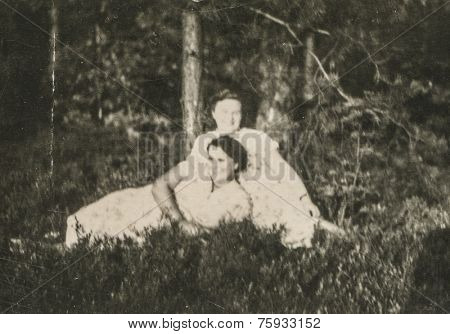 LODZ, POLAND, CIRCA FIFTIES - Vintage photo of two women resting in forest