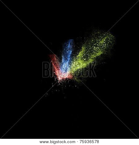 Stop Motion Of Red, Blue And Green Dust Explosion Isolated On Black Background