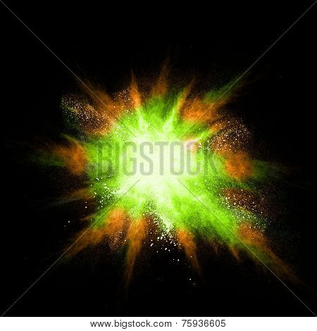 Stop Motion Of Green And Orange Dust Explosion Isolated On Black Background