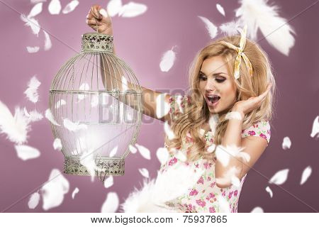 Glamorous Curvy Blonde Woman With A Sexy Body Posing In Dress On A Pink Studio Background.