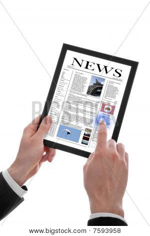 Male Hand Holding A Touchpad Pc Showing A Newspaper