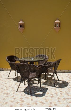 Table With Rattan Chairs