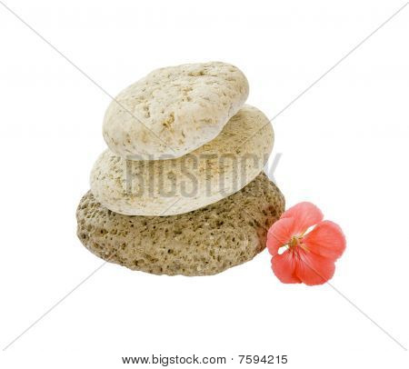 Close Up Stack Of Stones And A Pink Flower