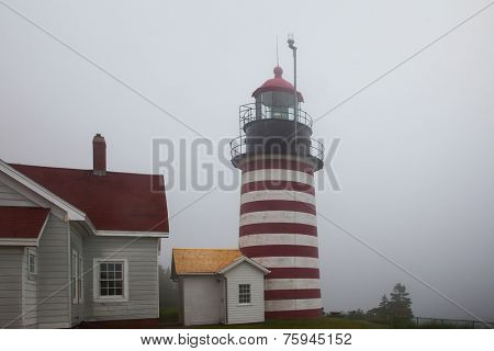 LUBEC-JULY 10: West Quody lighthouse in fogy day in Maine, USA on July 10, 2013.