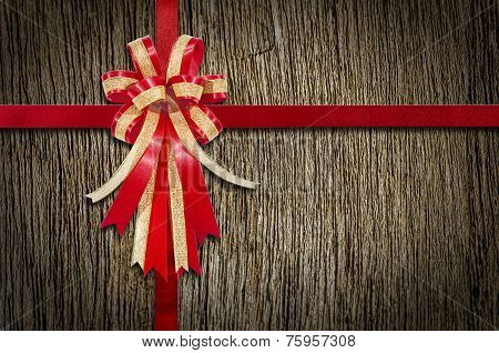 Red Ribbon On Wood For Background