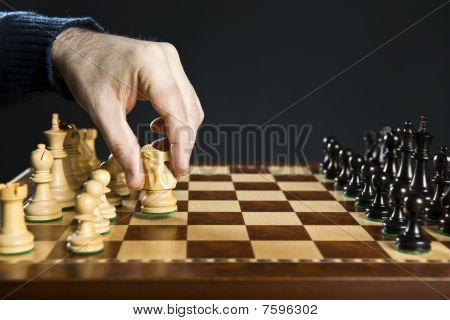 Hand Moving Knight On Chess Board