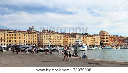 Marseille - July 2, 2014: Old Port (vieux-port) With People Walking Along The Promenade And Basilica