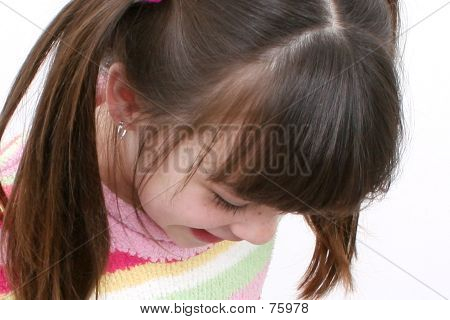 Seven Year Old Girl Striped Sweater Looking Down