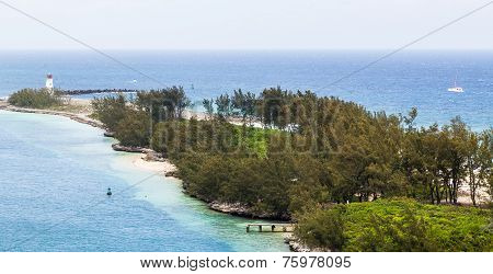 Lighthouse On Tropical Point Of Land In Bahamas