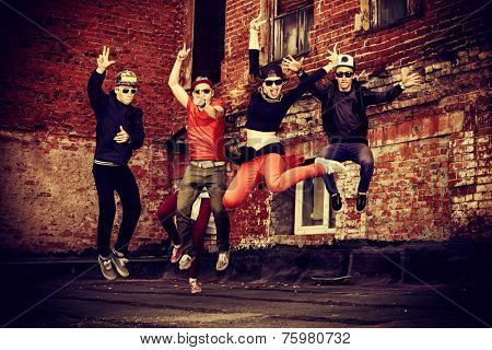 Modern dancers dancing on the street. Urban lifestyle. Hip-hop generation.