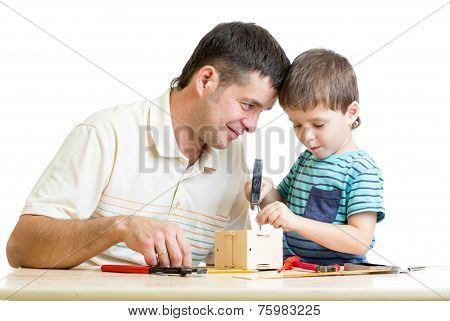 Man and kid child boy tinkering nesting box