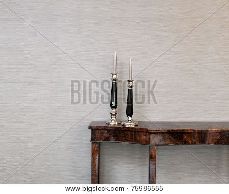 Sideboard In Front Of A Grey Wall With Luxury Candle Stick