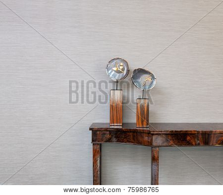 Sideboard In Front Of A Grey Wall With Gem Object