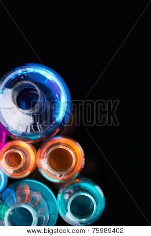 Glass tubes with multi-color liquids in isolation