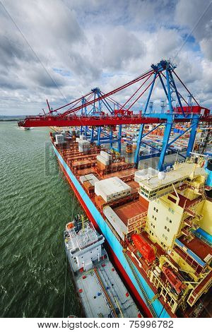 container-ship mored in a large container port, high-above perspective
