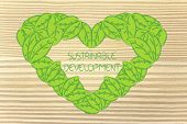 stock photo of sustainable development  - love heart made of leaves around the word Sustainable Development - JPG