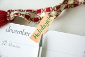 image of last day work  - pen point to holidays sticky note on december planner - JPG