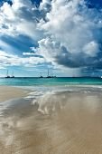 image of cloud formation  - Spectacular cloud formations over Anse Lazio Beach in the Seychelles reflected in the thin film of water on the golden sand below - JPG