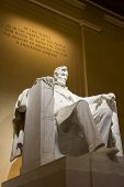 stock photo of abraham  - Abraham Lincoln memorial statue illuminated at night in Washington - JPG