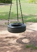 stock photo of tire swing  - Tire Swing and chain on sand have shadow - JPG