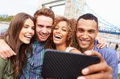 foto of bridge  - Group Of Friends Taking Selfie By Tower Bridge In London - JPG