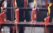 pic of emei  - burning incenses and candle in temple - JPG