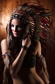picture of headdress  - Indian woman with traditional make up and headdress looking to the side - JPG