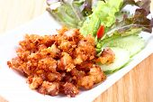 picture of fermentation  - Close up Deep fried sour fermented chicken knees tendon served with bird chili sliced cucumber and lettuce - JPG