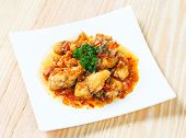 stock photo of grouper  - Close up deep fried grouper fish spicy sweet and sour sauce - JPG