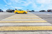 foto of zebra crossing  - cab at yellow and white crossing zebra of pedestrian crosswalk on road - JPG