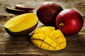 foto of mango  - mango on a dark wood background - JPG