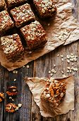 picture of walnut  - oatmeal cake with dates and walnuts on a dark wood background - JPG