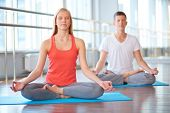 stock photo of youg  - Calm girl and guy doing yougs exercise for relaxation - JPG