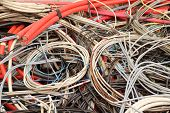 stock photo of landfill  - old electrical copper cables in a special waste landfill - JPG