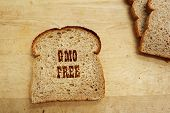image of wheat-free  - A bread slice with GMO Free text - JPG