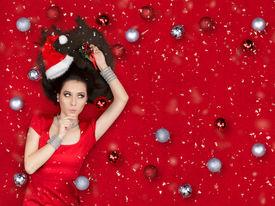 foto of flirty  - Beautiful surprised woman in Christmas fantasy portrait - JPG
