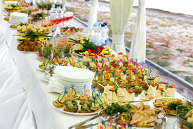 picture of banquet  - Numerous Dishes on the banquet table outdoors - JPG