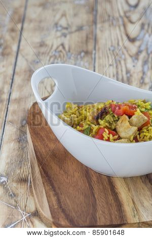 Bowl With Curry Flavored Rice Chicken And Vegetables