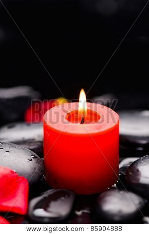 red petals with candle and therapy stones