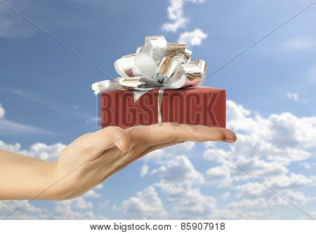 Female hand holding a gift box