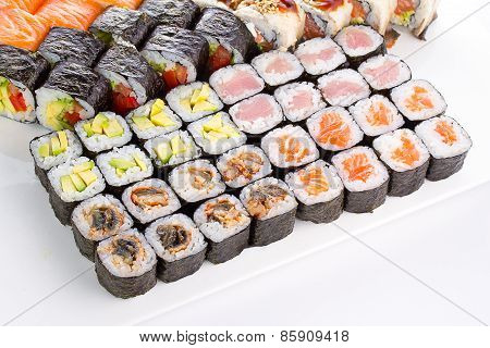 Sushi Set With Many Fresh And Tasty Ingredients Over White