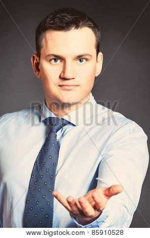 caucasian businessman is holding blank space in hands