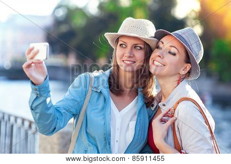 Two Happy Beautiful Girls Taken Picture Of Themself In The City