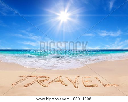 Word travel written on the tropical beach