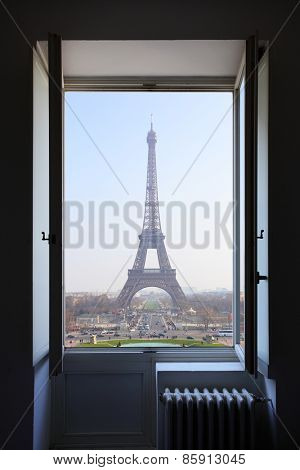 Open window and Eiffel Tower behind