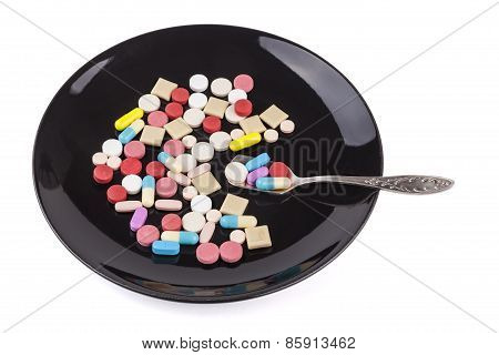 Pills In Black Plate