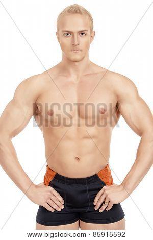 Professional sportsman bodybuilder man. Isolated over white.