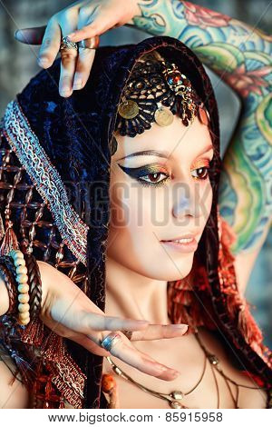 Close-up portrait of a magnificent traditional female dancer. Ethnic dance. Belly dancing. Tribal dancing. Make-up, cosmetics.