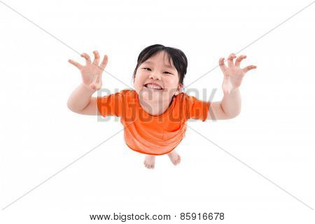 Full length portrait of a little girl standing hand gesture